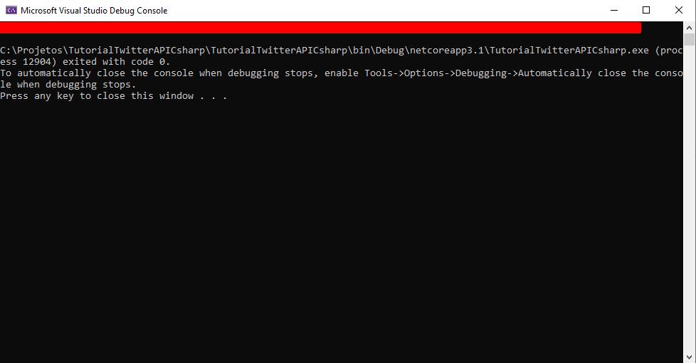 Print da tela de um Console do .NET, com uma caixa vermelha tampando o código de acesso que é o resultado do teste